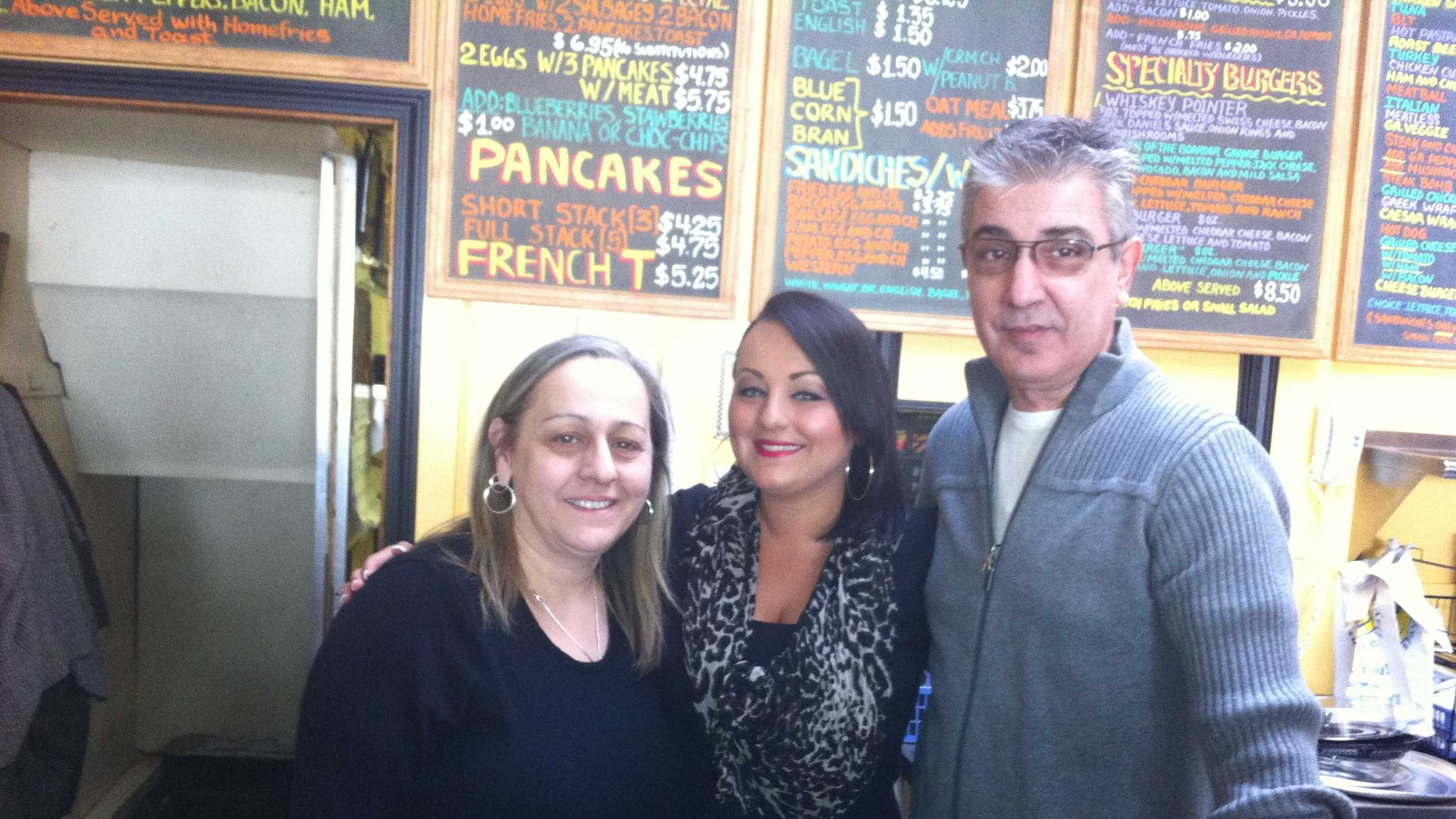 Owners Sophie & Tony Vessiropoulos and daughter Mel Anastasiadis at the counter of Sealey's on their last day of business.