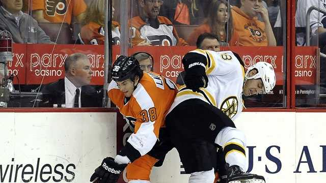 Boston Bruins' Nathan Horton (18) checks Philadelphia Flyers' Oliver Lauridsen (38), of Denmark, in the first period of an NHL hockey game, Saturday, March 30, 2013, in Philadelphia.