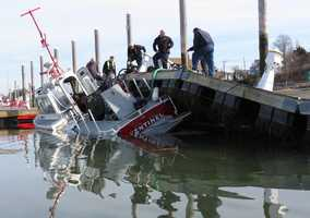 A Winthrop fire department boat took on water Sunday morning and caused the pier it was docked at to buckle.