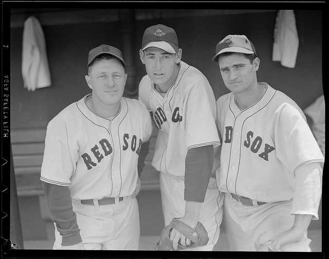 Boston Red Sox Gene Desautels, Ted Williams, and Bobby Doerr in the dugout at Fenway Park in 1940.