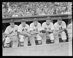"""(L to R:) Boston Red Sox Johnny Pesky, Bobby Doerr, """"Pinky"""" Higgins, Rip Russell, and Rudy York on the dugout steps at Fenway Park prior to the start of the 1946 World Series."""
