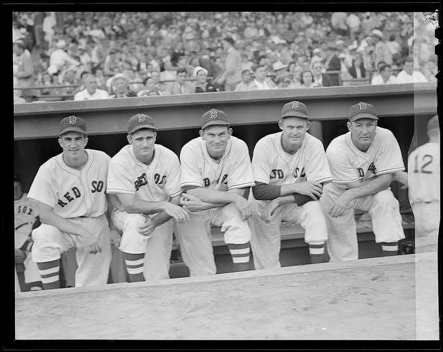 "(L to R:) Boston Red Sox Johnny Pesky, Bobby Doerr, ""Pinky"" Higgins, Rip Russell, and Rudy York on the dugout steps at Fenway Park prior to the start of the 1946 World Series."