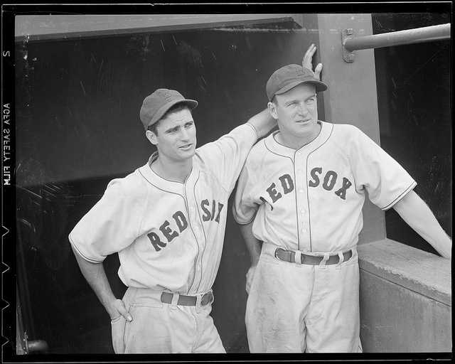 (L to R:) Boston Red Sox Bobby Doerr and manager Joe Cronin in the dugout at Fenway Park in 1938.