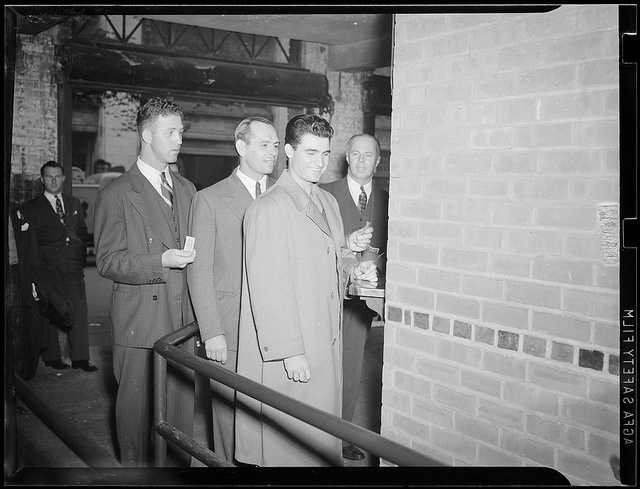 Boston Red Sox players purchasing tickets at the Fenway ticket window, (l to r:) Joe Dobson, Tom Carey and Bobby Doerr in the 1940s.