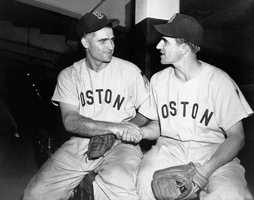 Bobby Doerr, left, Boston Red Sox second baseman, is congratulated by shortstop Johnny Pesky in the clubhouse at Yankee Stadium, July 1, 1951. Doerr got the 2,000th hit of his major league career during the Red Sox and New York Yankees game.