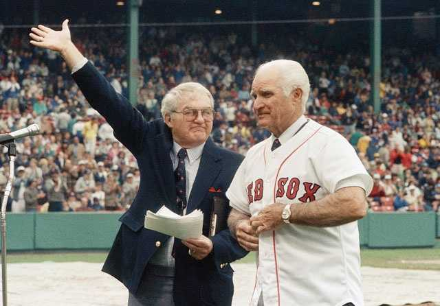 The radio voice of the Boston Red Sox Kent Coleman, left, presents former Red Sox second baseman Bobby Doerr, May 21, 1988 at Fenway Park during a ceremony to retire his number 1. Doerr, 70, played all of his 14 seasons in the majors with the Red Sox, totaling 1852 games at second base.