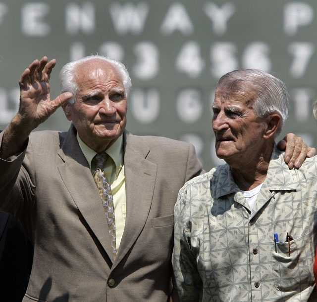 Boston Red Sox Hall of Famer Bobby Doerr, 89, left, waves to the crowd alongside former teammate Johnny Pesky at Fenway Park in Boston, prior to a baseball game between the Red Sox and the Baltimore Orioles, Aug. 2, 2007.