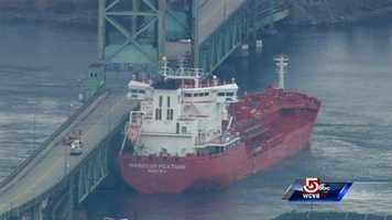 The U.S. Coast Guard says an oil tanker has crashed into a bridge that links Maine and New Hampshire
