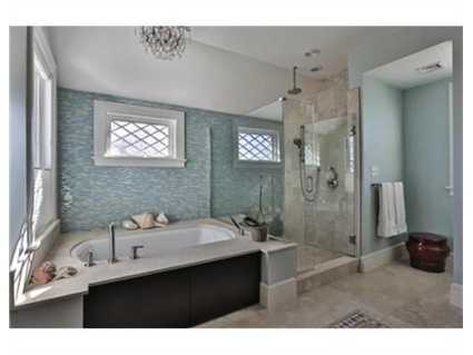 The home has 5 full bathrooms and 1 partial.