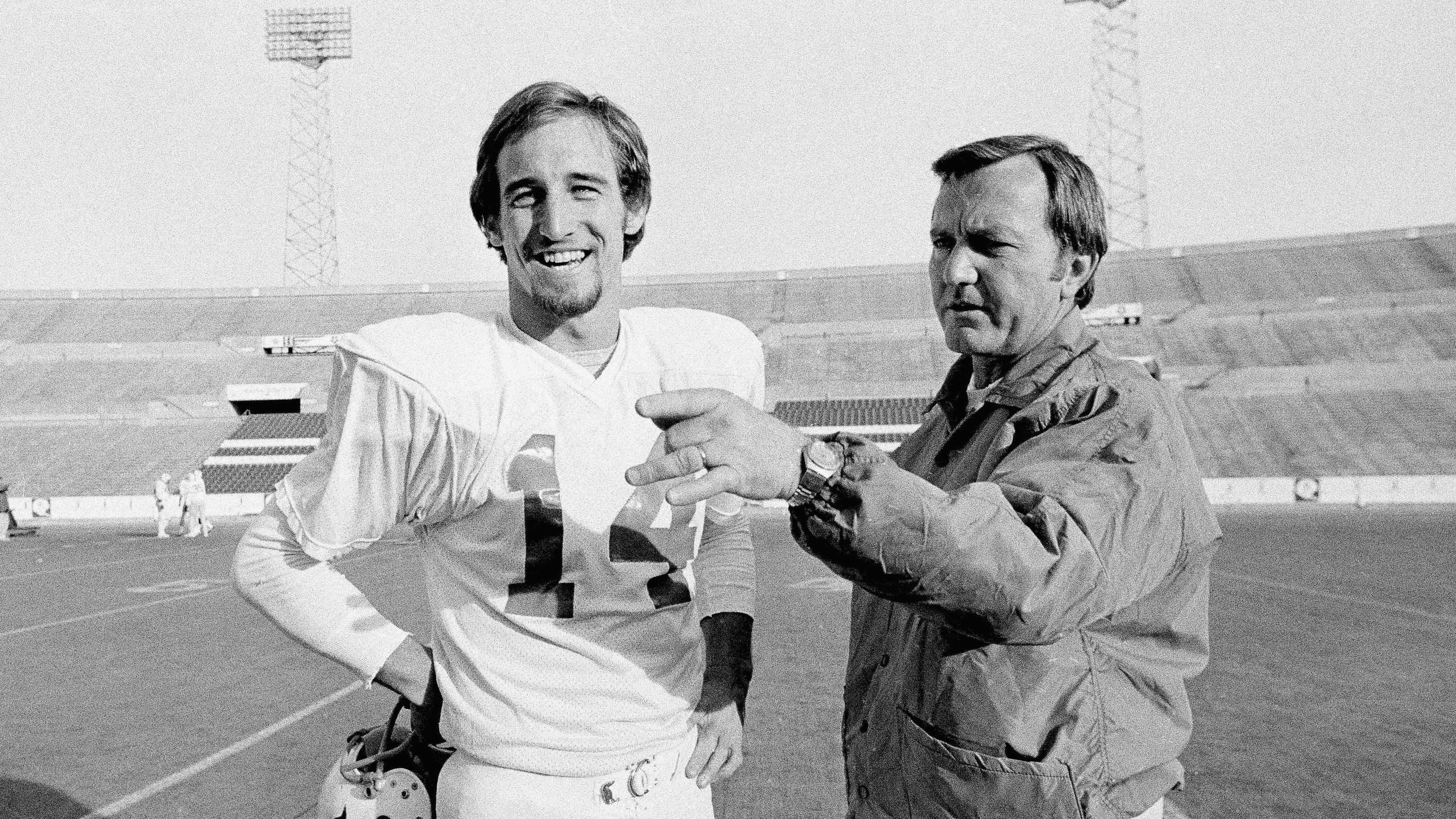 New England Patriots Coach Chuck Fairbanks, right, makes a point as he discusses play with quarterback Steve Grogan, during a workout on Dec. 15, 1976 at Schaefer Stadium in Foxboro as they prepared for playoff game with Oakland Raiders.