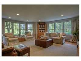 The home features large windows and recessed lighting.