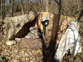 Images of an underground suburb used by the homeless on the city's northeast side near Interstate 435. The camp was broken up by Kansas City Police on Friday.