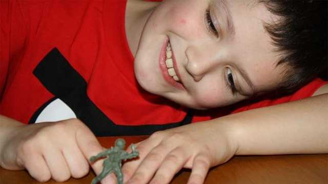 "Brendan Haas, 10, plays with a toy soldier in his home in Kingston. He has received national attention for ""A Soldier for a Soldier"" initiative, in which he has donated two Disney trips to the families of fallen soldiers."