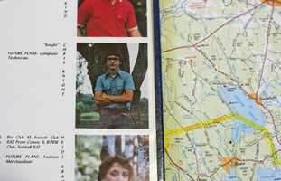 A 1984 yearbook, opened to a page showing Christopher Knight, is displayed on a map. Knight was arrested when he was allegedly caught stealing from a food pantry.