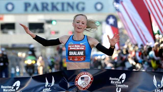 Shalane Flanagan reacts as she crosses the finish line winning the women's U.S. Olympic Trials Marathon, Jan. 14, 2012, in Houston.