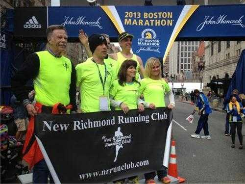 Running group from Wisconsin poses for a photo at the finish line.