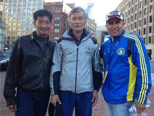 These three men are from Texas, Houston to be specific. The man in the middle is running his 30th marathon!