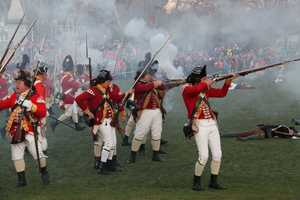 Historians have differing views on whether the British or the Colonials fired the first shot.