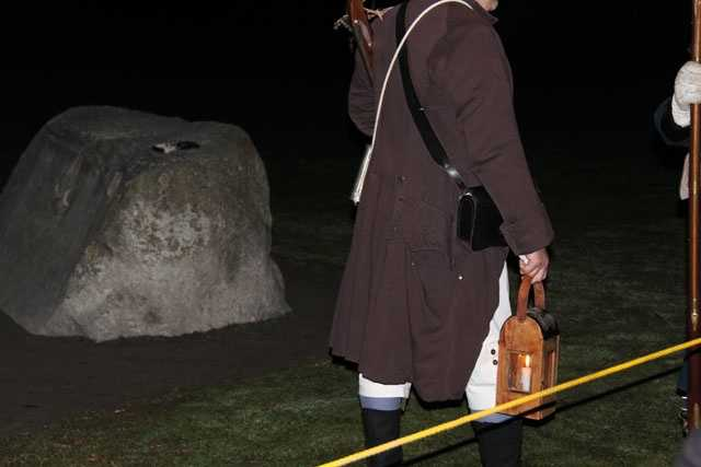 In the pre-dawn hours, reenactors gathered on the Lexington Common for the 238th anniversary of the Battle of Lexington.
