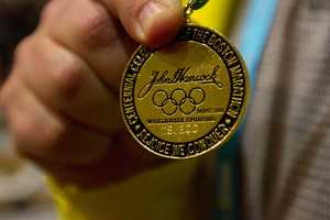James Usevich, who has been a volunteer for Boston Athletic Association for 21 years, is wearing a commemorative medal of 1996 Boston Marathon.