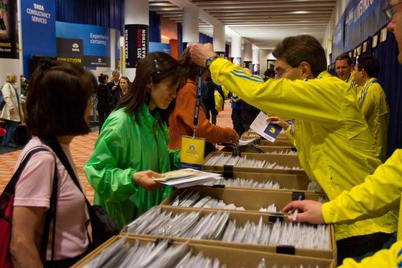 Shinobu Sugiyama from Tokyo, Japan is picking her first Boston Marathon runner's passport