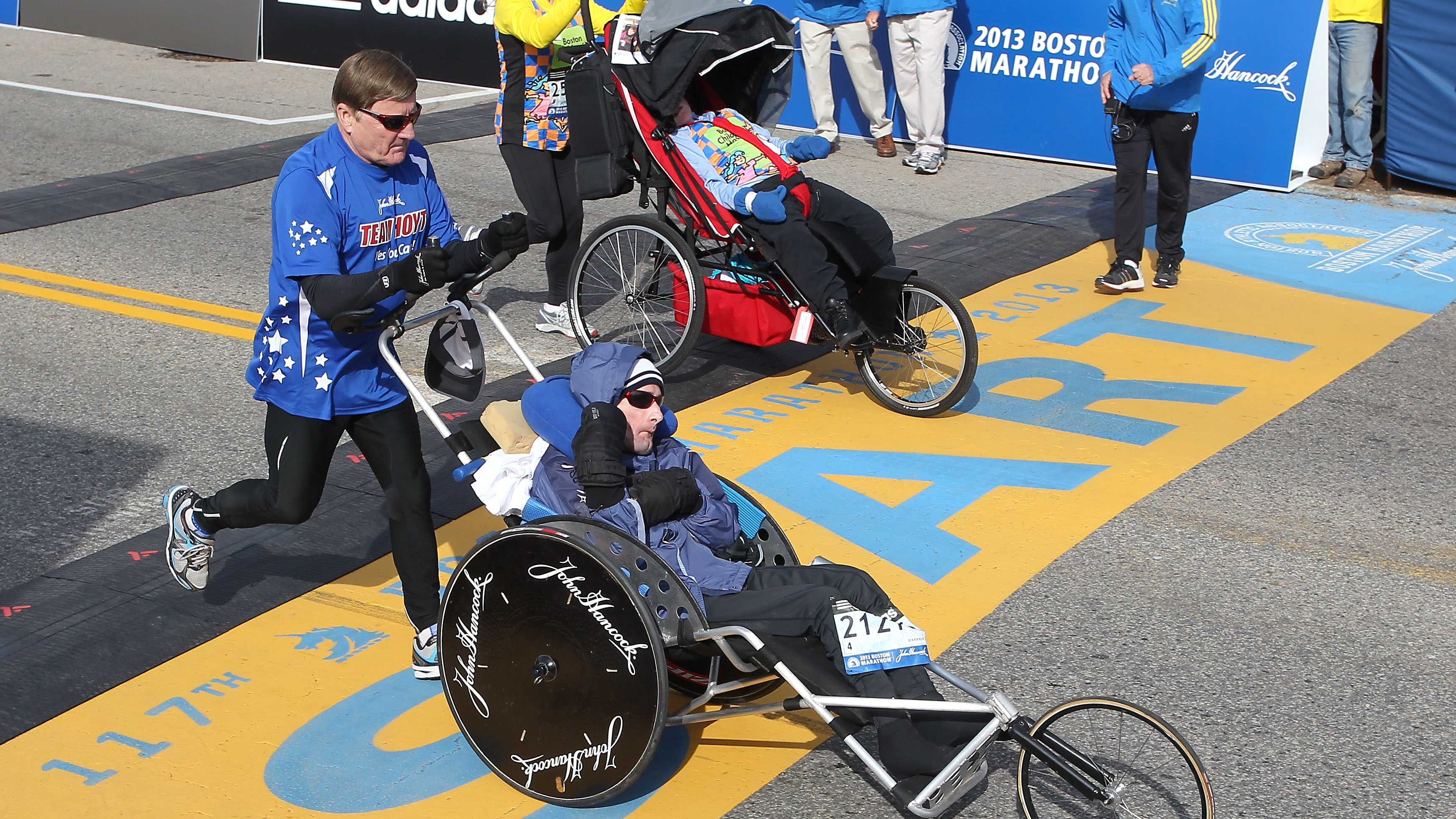 Dick Hoyt, left, and his son, Rick, start of the 117th running of the Boston Marathon, in Hopkinton.