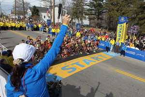 Jacqueline Benson shoots the starting piston for the elite women's start of the 117th running of the Boston Marathon.