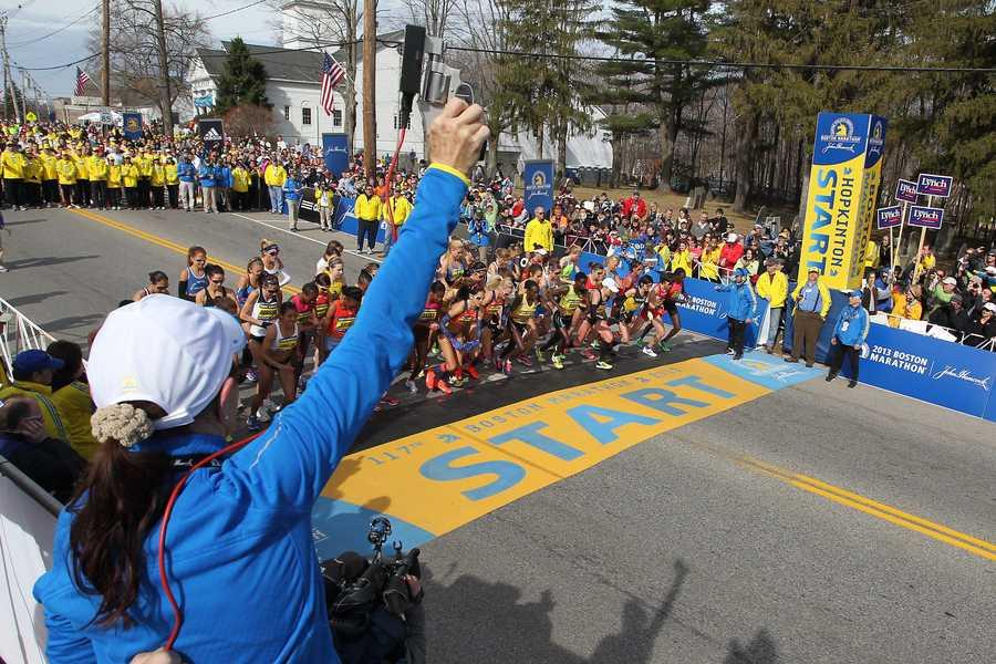 Jacqueline Benson shoots the starting piston for the elite women's start of the 117th running of the Boston Marathon.