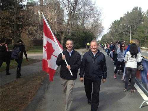 International Spirit!Members of the Canadian Consulate in Boston march down the marathon route with the Canadian flag, supporting all the runners from Canada