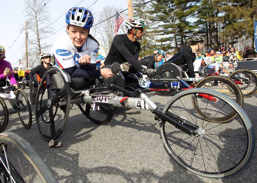 Defending champion Shirley Reilly, left, gets her wheelchair into position prior to the start of the wheelchair division of the 117th running of the Boston Marathon.