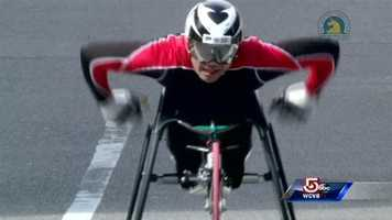 Hiroyuki Yamamoto crosses the finish line to win the men's wheelchair division