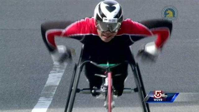 Hiroyuki Yamamoto crosses the finish line to win the men's wheelchair division