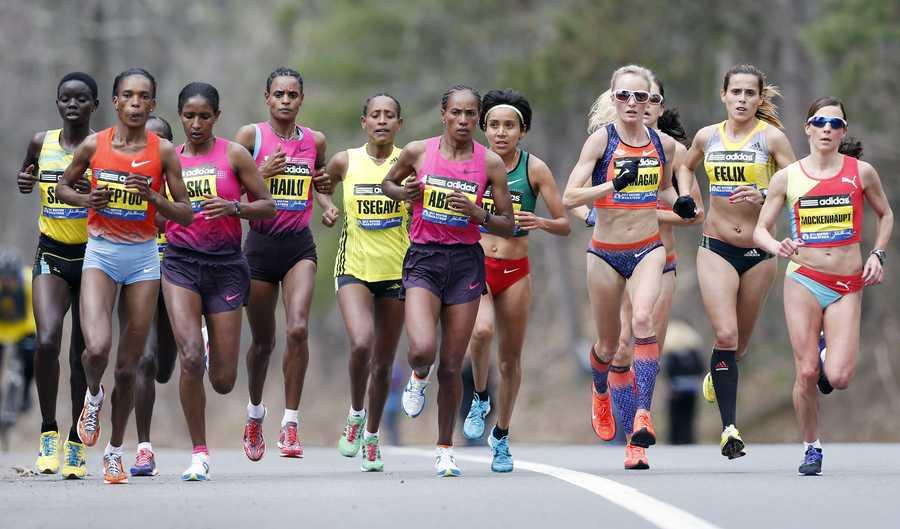 Elite female marathoners, front row from left, Rita Jeptoo, Mamitu Daska, Meserat Debele, Tirifi Beyene, Alemitu Begna, Shalane Flanagan, Ana Felix and Sabrina Mockenhaupt compete on the course in Wellesley