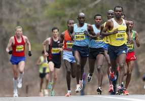 Elite mens marathoners including Levy Matebo, fourth from left, and Markos Geneti, front right, run in the 117th Boston Marathon in Wellesley.