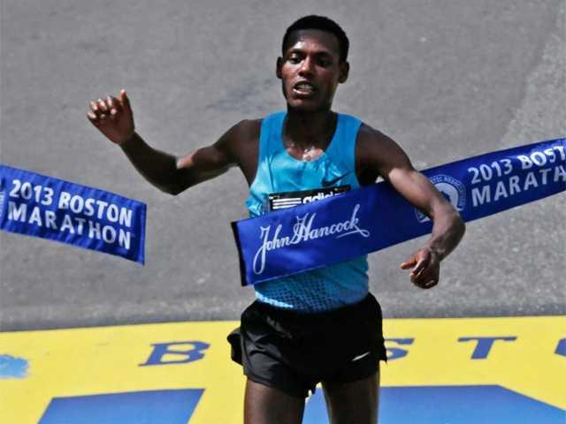 Lelisa Desisa, of Ethiopia, breaks the finish line tape to win the 2013 running of the Boston Marathon in Boston, April 15, 2013.