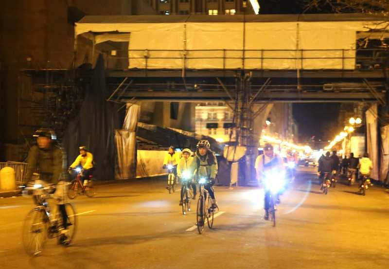 Cyclists crossed the finish line of the Boston Marathon during the Midnight Marathon bike ride. Over 700 cyclists participated in the ride, which covered the entire marathon course, spanning from Hopkinton to Copley Square.