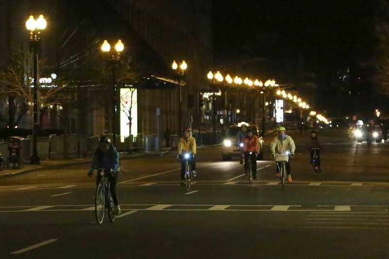Participants in the annual Boston Midnight Bike Marathon ride down Boylston Street at 1 a.m. on their way to crossing the official finish line of the Boston Marathon.
