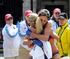 Kara Goucher and Shalane Flanagan, embrace after completing the 117th Boston Marathon in Copley Square. Goucher came in 6th place while Flanagan finished in 4th place overall.