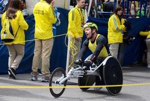 Jason Fowler completes the 117th Boston Marathon in Copley Square, coming in 36th place in the Male Open Wheelchair Race. Fowler has completed over 150 road races, 30 marathons and 29 triathalons and won the 2009 Ironman World Championships.