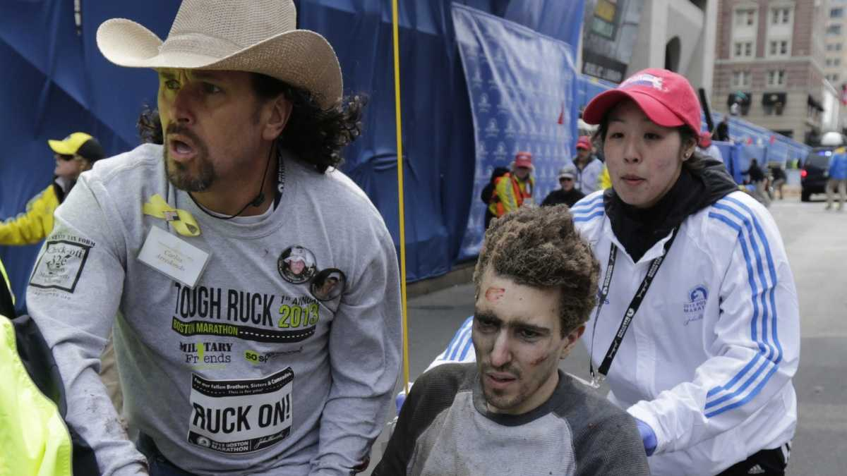 Jeff Bauman Jr., of Chelmsford, seen here with Carlos Arredondo in the moments after the blast, lost two legs.