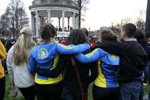 People congregate at Boston Common for a vigil for the victims of the Boston Marathon explosions, one day after bombs exploded at the finish line of the Boston Marathon.