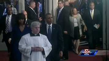 President Barack Obama and the First Lady arrive at the Cathedral.