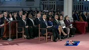Governor and Mrs. Patrick are sitting to the left of President and Mrs. Obama.