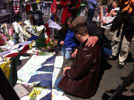 Condolence messages are written at the site.