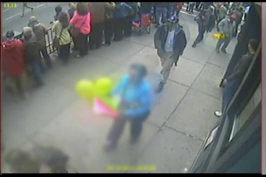 The two men identified in the Boston Marathon bombings were located directly behind the woman, who sustained injuries in the bombing, according to media reports.