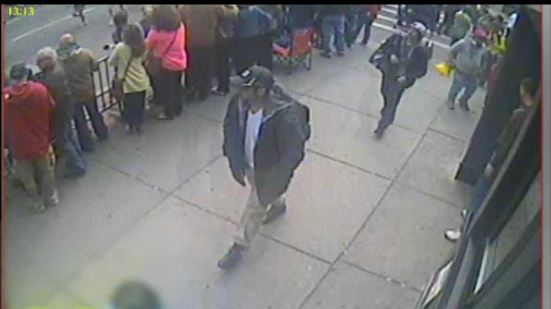This is a screen grab from surveillance video of Suspect 1 walking down Boylston Street. The timestamp on the video is 2:37:39.