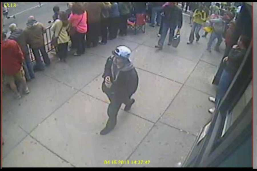 The man identified as suspect 2 by the FBI is located just a few footsteps behind the first suspect.