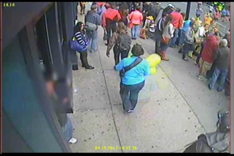 This video image is looking the opposite direction down Boylston Street. It shows the woman with balloons walking down the street. Timestamp on the video is 2:37:38.