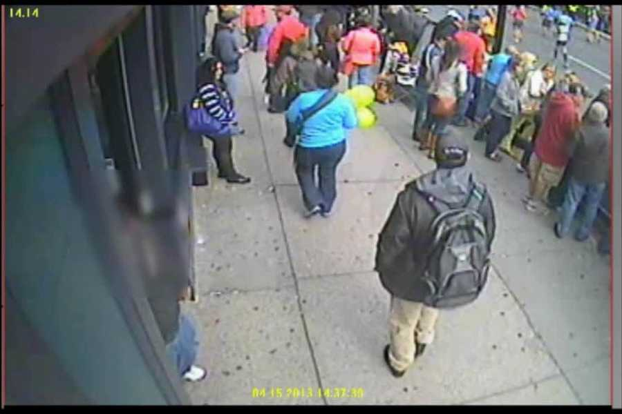 The back of suspect No. 1 enters the video.