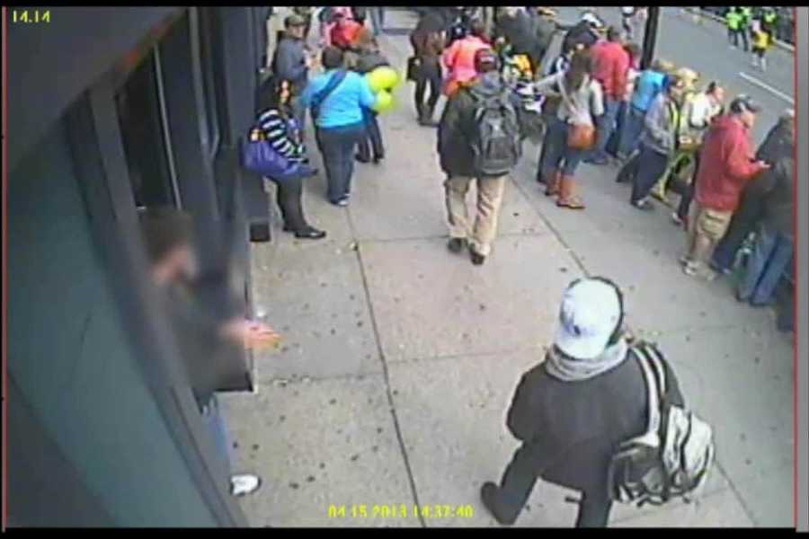 Suspect #1 continues walking down Boylston Street as Suspect #2 (white hat) enters the frame.